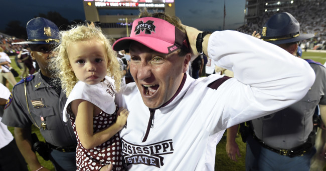Oct 11, 2014; Starkville, MS, USA; Mississippi State Bulldogs head coach Dan Mullen with his daughter Breelyn Mullen celebrate their 38-23 victory over the Auburn Tigers at Davis Wade Stadium. Mandatory Credit: John David Mercer-USA TODAY Sports