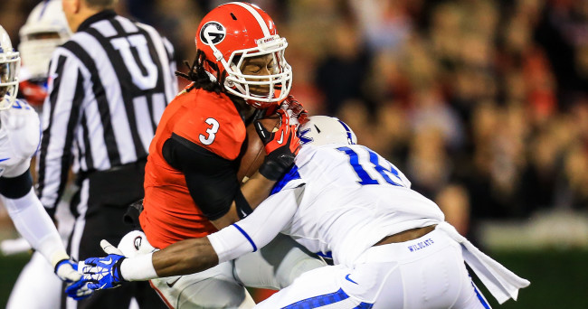 Nov 23, 2013; Athens, GA, USA; Georgia Bulldogs running back Todd Gurley (3) is tackled on a run by Kentucky Wildcats safety Glenn Faulkner (18) in the first half at Sanford Stadium. Mandatory Credit: Daniel Shirey-USA TODAY Sports