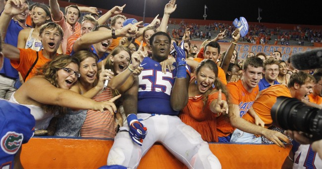 Sep 13, 2014; Gainesville, FL, USA; Florida Gators offensive linesman Roderick Johnson (55) celebrates with fans after they beat the Kentucky Wildcats during overtime at Ben Hill Griffin Stadium. Florida Gators defeated the Kentucky Wildcats 36-30 in triple overtime. Mandatory Credit: Kim Klement-USA TODAY Sports