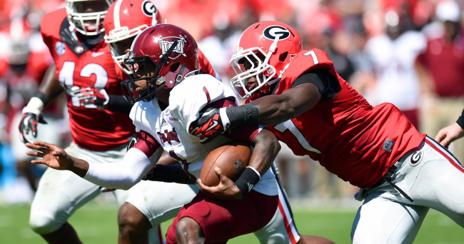 Sep 20, 2014; Athens, GA, USA; Troy Trojans quarterback Dontreal Pruitt (1) is tackled by Georgia Bulldogs linebacker Lorenzo Carter (7) during the second half at Sanford Stadium. Georgia defeated Troy 66-0. Mandatory Credit: Dale Zanine-USA TODAY Sports
