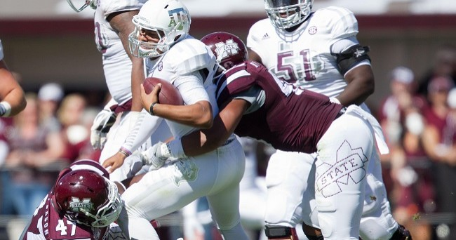 Oct 4, 2014; Starkville, MS, USA; Mississippi State Bulldogs defensive lineman A.J. Jefferson (47) and defensive lineman Ryan Brown (48) sack Texas A&M Aggies quarterback Kenny Hill (7) at Davis Wade Stadium. The Bulldogs defeated the Aggies 48-31. Mandatory Credit: Marvin Gentry-USA TODAY Sports