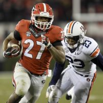 Nov 15, 2014; Athens, GA, USA; Georgia Bulldogs running back Nick Chubb (27) runs past Auburn Tigers defensive back Johnathan Ford (23) during the second half at Sanford Stadium. Georgia defeated Auburn 34-7. Mandatory Credit: Dale Zanine-USA TODAY Sports