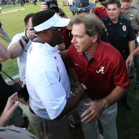 Sep 14, 2013; College Station, TX, USA; Alabama Crimson Tide head coach Nick Saban talks with Texas A&M Aggies head coach Kevin Sumlin after the game at Kyle Field. Alabama Crimson Tide beat the Texas A&M Aggies 49-42. Mandatory Credit: Matthew Emmons-USA TODAY Sports