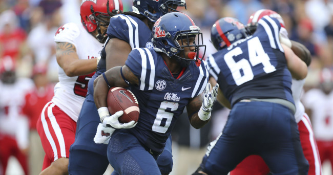 Sep 13, 2014; Oxford, MS, USA; Mississippi Rebels running back Jaylen Walton (6) carries the ball resulting in a touchdown during the game against the Louisiana-Lafayette Ragin Cajuns at Vaught-Hemingway Stadium. The Rebels won 56-15.  Mandatory Credit: Spruce Derden-USA TODAY Sports