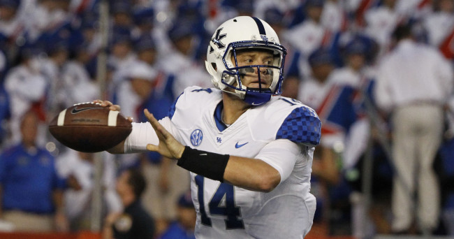 Sep 13, 2014; Gainesville, FL, USA; Kentucky Wildcats quarterback Patrick Towles (14) throws the ball during the first quarter against the Florida Gators at Ben Hill Griffin Stadium. Mandatory Credit: Kim Klement-USA TODAY Sports