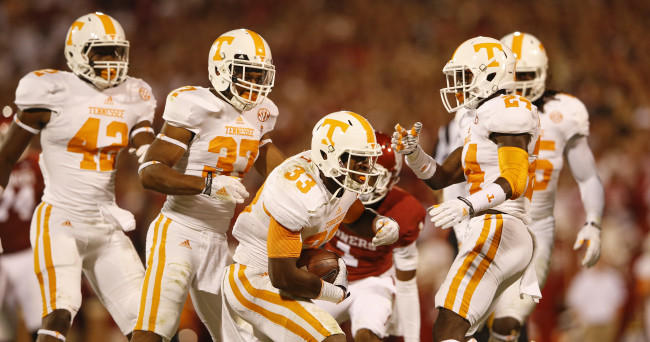 Sep 13, 2014; Norman, OK, USA; Tennessee Volunteers defensive back LaDarrell McNeil (33) celebrates with teammates after making an interception during the first half against the Oklahoma Sooners at Gaylord Family - Oklahoma Memorial Stadium. Mandatory Credit: Kevin Jairaj-USA TODAY Sports