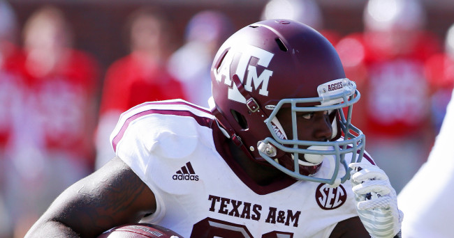 Sep 20, 2014; Dallas, TX, USA; Texas A&M Aggies running back Tra Carson (21) carries the ball in the second half against the Southern Methodist Mustangs at Gerald J. Ford Stadium. Texas A&M beat Southern Methodist 58-6. Mandatory Credit: Tim Heitman-USA TODAY Sports