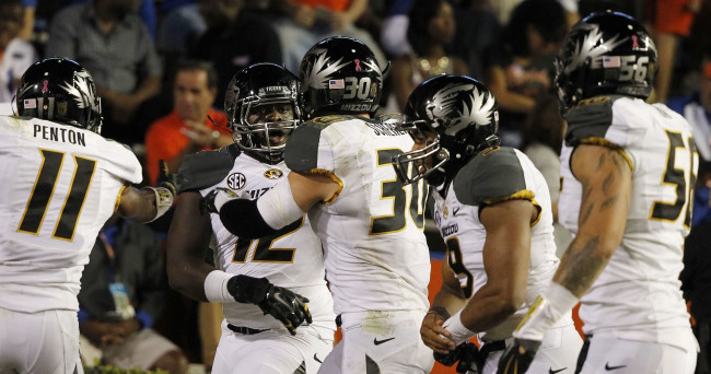 Oct 18, 2014; Gainesville, FL, USA; Missouri Tigers linebacker Darvin Ruise (12) celebrates with teammates after scoring a touchdown against the Florida Gators during the second half at Ben Hill Griffin Stadium. The Tigers won 42-13. Mandatory Credit: Kim Klement-USA TODAY Sports