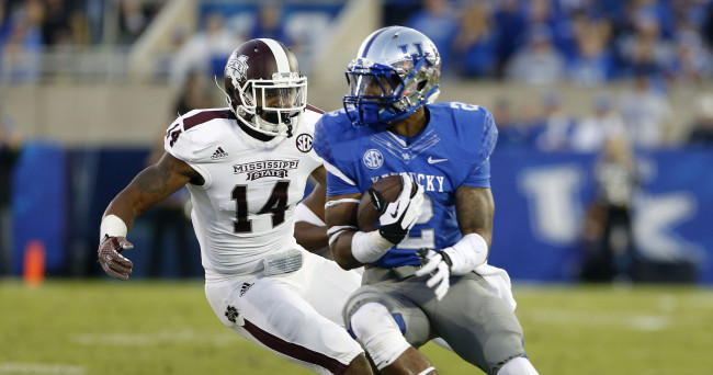 Oct 25, 2014; Lexington, KY, USA; Kentucky Wildcats wide receiver Dorian Baker (2) runs the ball against Mississippi State Bulldogs linebacker Zach Jackson (14) in the second half at Commonwealth Stadium. Mississippi State defeated Kentucky 45-31. Mandatory Credit: Mark Zerof-USA TODAY Sports