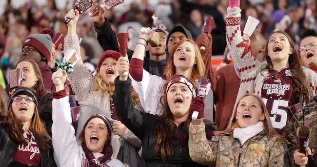 Nov 1, 2014; Starkville, MS, USA; Mississippi State Bulldogs fans ring their cowbells during the game against the Arkansas Razorbacks at Davis Wade Stadium. Mandatory Credit: Marvin Gentry-USA TODAY Sports
