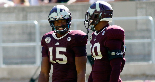 Nov 1, 2014; College Station, TX, USA; Texas A&M Aggies defensive linemen Myles Garrett (15) and Daeshon Hall (10) during the fourth quarter at Kyle Field. Texas A&M Aggies won 21-16. Mandatory Credit: Ray Carlin-USA TODAY Sports