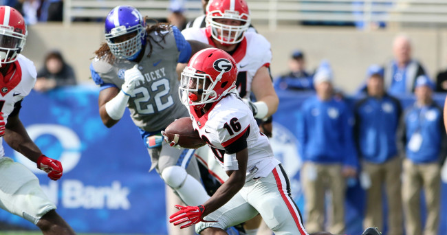 Nov 8, 2014; Lexington, KY, USA; Georgia Bulldogs wide receiver Isaiah McKenzie (16) runs the ball against the Kentucky Wildcats in the first half at Commonwealth Stadium. Mandatory Credit: Mark Zerof-USA TODAY Sports