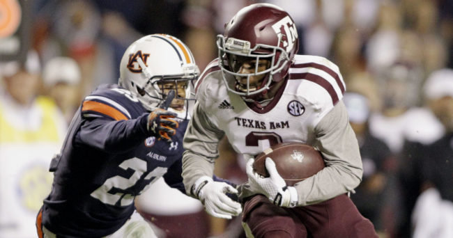 Nov 8, 2014; Auburn, AL, USA; Texas A&M Aggies receiver Speedy Noil (2) avoids the tackle of Auburn Tigers defensive back Jonathan Ford (23) during the second half at Jordan Hare Stadium  The Aggies beat the Tigers 41-38. Mandatory Credit: John Reed-USA TODAY Sports