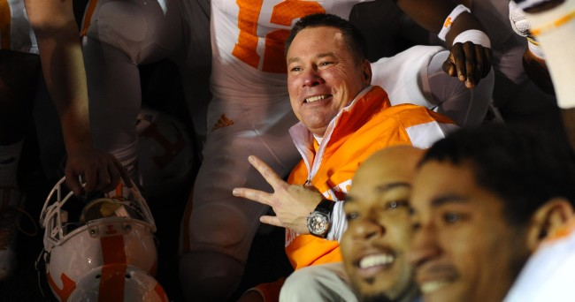 Nov 29, 2014; Nashville, TN, USA; Tennessee Volunteers head coach Butch Jones celebrates with players after a win against the Vanderbilt Commodores at Vanderbilt Stadium. The Volunteers won 24-17. Mandatory Credit: Christopher Hanewinckel-USA TODAY Sports