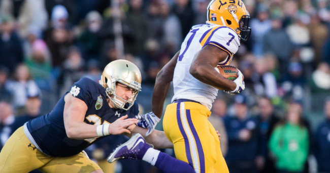 Dec 30, 2014; Nashville, TN, USA; Notre Dame Fighting Irish kicker Kyle Brindza (27) attempts to tackle Louisiana State Tigers running back Leonard Fourenette (7) on a kickoff return in the second quarter at LP Field. Fournette scored a touchdown on the play. Mandatory Credit: Matt Cashore-USA TODAY Sports