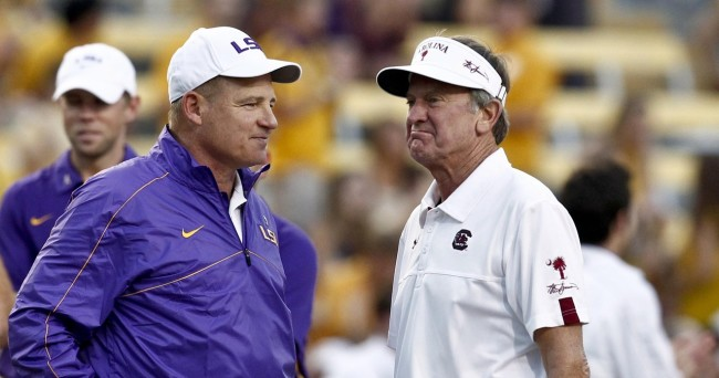October 13, 2012; Baton Rouge, LA, USA; LSU Tigers head coach Les Miles and South Carolina Gamecocks head coach Steve Spurrier talk on the field prior to kickoff of a game at Tiger Stadium.  Mandatory Credit: Derick E. Hingle-US PRESSWIRE ORG XMIT: USPW-91172 ORIG FILE ID:  20121013_jla_ah6_638.jpg