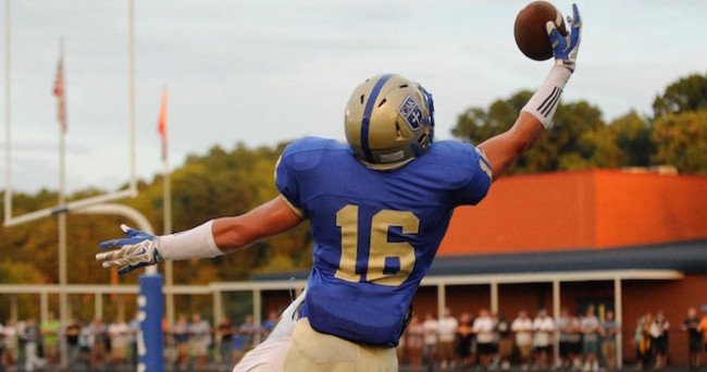 CAK's Austin Pope (16) leaps to make a one-handed touchdown catch against Catholic during the first half at Christian Academy of Knoxville in Knoxville on Friday, Sept. 5, 2014. (ADAM LAU/NEWS SENTINEL)