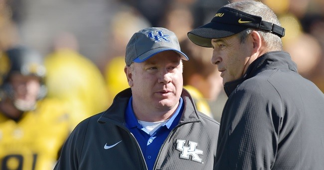 Nov 1, 2014; Columbia, MO, USA; Kentucky Wildcats head coach Mark Stoops (left) talks with Missouri Tigers head coach Gary Pinkel before the game at Faurot Field. Mandatory Credit: Denny Medley-USA TODAY Sports
