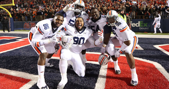 Nov 1, 2014; Oxford, MS, USA; Auburn Tigers defensive lineman DaVonte Lambert (86) Ben Bradley (50) Gabe Wright (90) Jeffrey Whitaker (54) and Angelo Blackson (98) celebrate at the conclusion of the game against the Ole Miss Rebels at Vaught-Hemingway Stadium. Auburn defeated Ole Miss 35-31. Mandatory Credit: Nelson Chenault-USA TODAY Sports