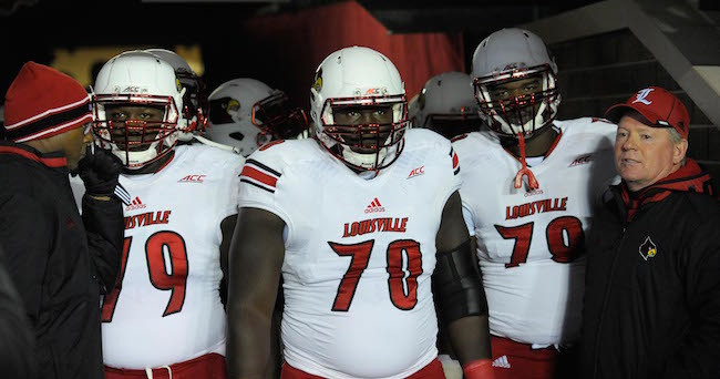Nov 8, 2014; Boston, MA, USA; Louisville Cardinals offensive tackle Jamon Brown (79) offensive lineman John Miller (70) offensive tackle Aaron Epps (78) and head coach Bobby Petrino get set to take the field against the Boston College Eagles at Alumni Stadium. Mandatory Credit: Bob DeChiara-USA TODAY Sports