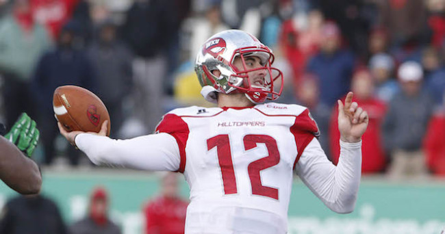 Nov 28, 2014; Huntington, WV, USA; Western Kentucky Hilltoppers quarterback Brandon Doughty (12) passes the ball against the Marshall Thundering Herd at Joan C. Edwards Stadium.   Mandatory Credit: Mark Zerof-USA TODAY Sports