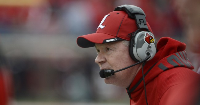 Nov 29, 2014; Louisville, KY, USA; Louisville Cardinals head coach Bobby Petrino watches from sideline during the second quarter against the Kentucky Wildcats at Papa John's Cardinal Stadium. Louisville defeated Kentucky 44-40.  Mandatory Credit: Jamie Rhodes-USA TODAY Sports
