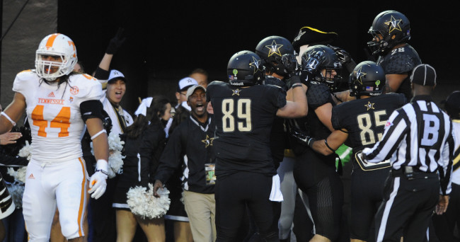 Nov 29, 2014; Nashville, TN, USA; Vanderbilt Commodores players celebrate after a touchdown  during the first half against the Tennessee Volunteers at Vanderbilt Stadium. Mandatory Credit: Christopher Hanewinckel-USA TODAY Sports