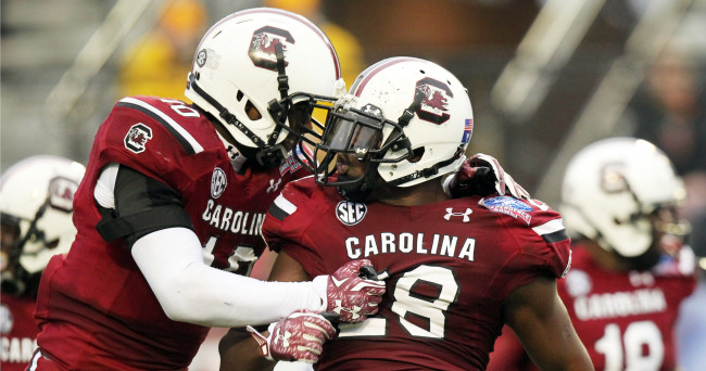 Dec 27, 2014; Shreveport, LA, USA; South Carolina Gamecocks linebacker Skai Moore (10) and linebacker Jonathan Walton (28) celebrate after an interception by Walton in the second quarter against the Miami Hurricanes in the 2014 Independence Bowl at Independence Stadium. Mandatory Credit: Nelson Chenault-USA TODAY Sports