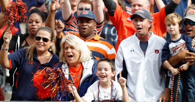 Jan 1, 2015; Tampa, FL, USA; Auburn Tigers fans cheer against the Wisconsin Badgers during the second half in the 2015 Outback Bowl at Raymond James Stadium. Wisconsin Badgers defeated the Auburn Tigers 34-31 in overtime. Mandatory Credit: Kim Klement-USA TODAY Sports