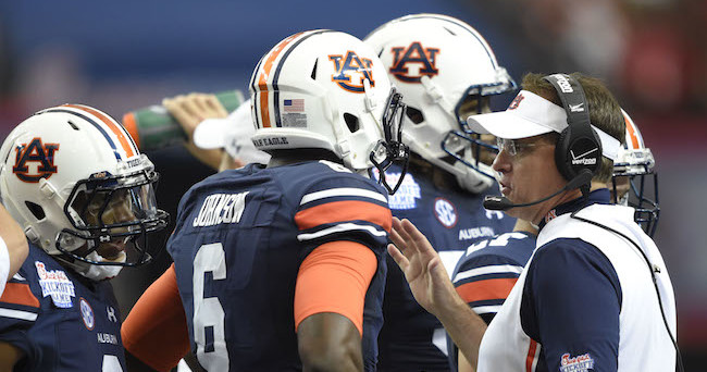 Sep 5, 2015; Atlanta, GA, USA; Auburn Tigers head coach Gus Malzahn talks to quarterback Jeremy Johnson (6) during the first quarter against the Louisville Cardinals in the 2015 Chick-fil-A Kickoff Game at the Georgia Dome. Mandatory Credit: John David Mercer-USA TODAY Sports