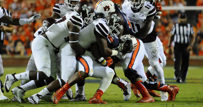 Sep 26, 2015; Auburn, AL, USA; Auburn Tigers running back Peyton Barber (25) is brought down by Mississippi State Bulldogs defense during the first quarter at Jordan Hare Stadium. Mandatory Credit: Shanna Lockwood-USA TODAY Sports
