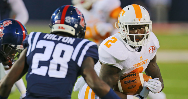 Oct 18, 2014; Oxford, MS, USA; Tennessee Volunteers wide receiver Pig Howard (2) advances the ball against Mississippi Rebels defensive back Mike Hilton (28) during the game at Vaught-Hemingway Stadium. Mandatory Credit: Spruce Derden-USA TODAY Sports