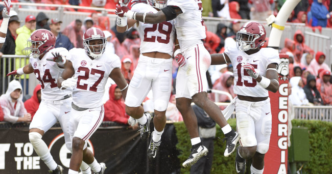 Oct 3, 2015; Athens, GA, USA; Alabama Crimson Tide defensive back Minkah Fitzpatrick (29) celebrates a blocked punt returned for a touchdown during the second quarter against the Georgia Bulldogs at Sanford Stadium. Mandatory Credit: John David Mercer-USA TODAY Sports