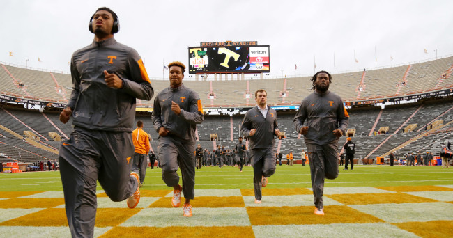 Oct 3, 2015; Knoxville, TN, USA; Tennessee Volunteers players run on the field prior to their game against the Arkansas Razorbacks at Neyland Stadium. Mandatory Credit: Randy Sartin-USA TODAY Sports