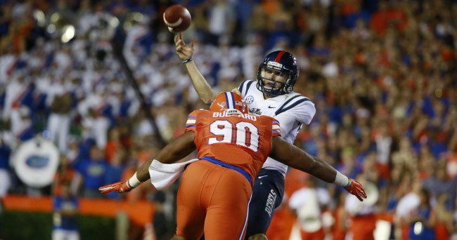 Oct 3, 2015; Gainesville, FL, USA; Mississippi Rebels quarterback Chad Kelly (10) throws the ball as Florida Gators defensive lineman Jonathan Bullard (90) pressures during the first half at Ben Hill Griffin Stadium. Mandatory Credit: Kim Klement-USA TODAY Sports