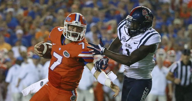 Oct 3, 2015; Gainesville, FL, USA; Florida Gators quarterback Will Grier (7) runs with the ball as Mississippi Rebels defensive back Tony Bridges (1) defends during the second half at Ben Hill Griffin Stadium. Florida Gators defeated the Mississippi Rebels 38-10. Mandatory Credit: Kim Klement-USA TODAY Sports