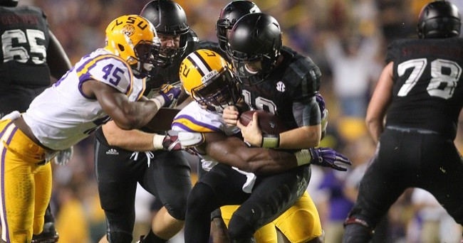 Nov 28, 2015; Baton Rouge, LA, USA; Texas A&M Aggies quarterback Kyle Allen (10) is sacked by LSU Tigers defensive end Lewis Neal (92) in the second quarter at Tiger Stadium. Mandatory Credit: Crystal LoGiudice-USA TODAY Sports