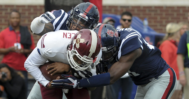 Oct 10, 2015; Oxford, MS, USA; Mississippi Rebels defensive tackle Robert Nkemdiche (5) and Mississippi Rebels linebacker Denzel Nkemdiche (4) tackle New Mexico State Aggies quarterback Nick Jeanty (12) during the game at Vaught-Hemingway Stadium. Mandatory Credit: Justin Ford-USA TODAY Sports