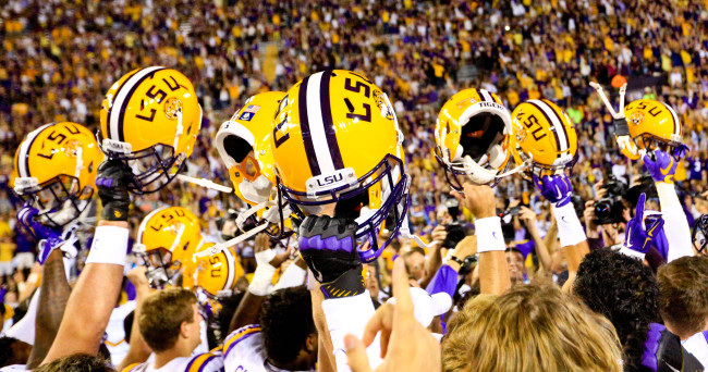 Oct 17, 2015; Baton Rouge, LA, USA; LSU Tigers players celebrate a win against the Florida Gators in a game at Tiger Stadium. LSU defeated Florida 35-28. Mandatory Credit: Derick E. Hingle-USA TODAY Sports