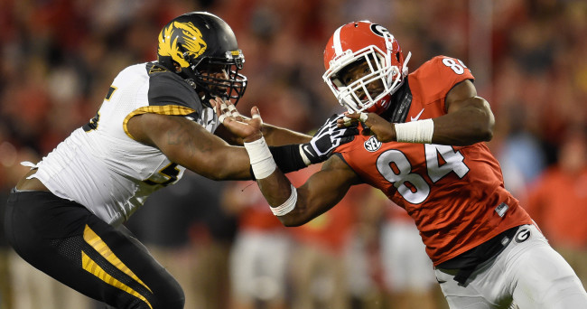 Oct 17, 2015; Athens, GA, USA; Georgia Bulldogs linebacker Leonard Floyd (84) and Missouri Tigers offensive lineman Nate Crawford (55) battle during the second half at Sanford Stadium. Georgia defeated Missouri 9-6. Mandatory Credit: Dale Zanine-USA TODAY Sports