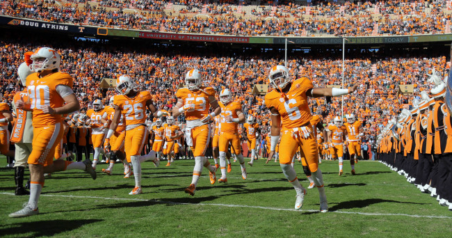 Nov 14, 2015; Knoxville, TN, USA; The Tennessee Volunteers run through the T before the game against the North Texas Mean Green at Neyland Stadium. Mandatory Credit: Randy Sartin-USA TODAY Sports