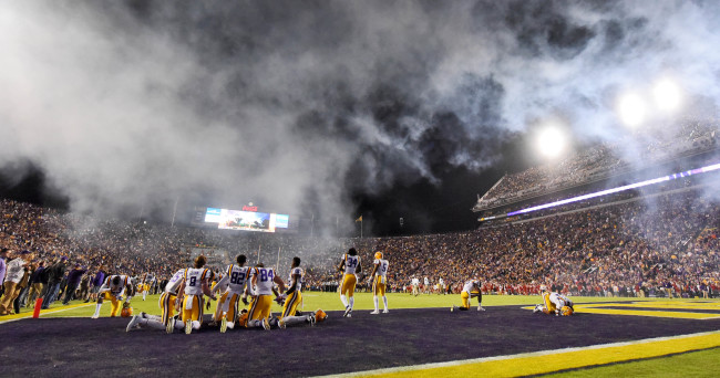 Nov 14, 2015; Baton Rouge, LA, USA; The LSU Tigers kneel in prayer in the end zone prior to kickoff against the Arkansas Razorbacks at Tiger Stadium. The Razorbacks won 31-14. Mandatory Credit: Crystal LoGiudice-USA TODAY Sports