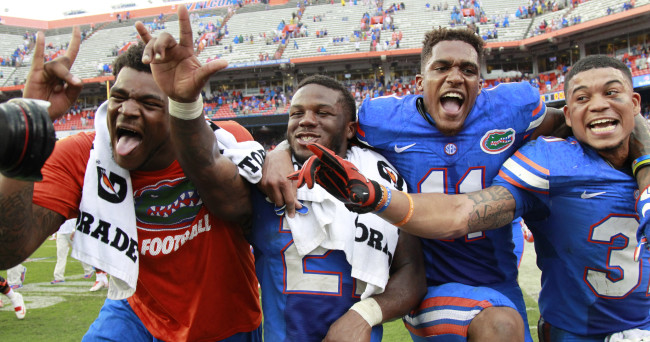 Nov 21, 2015; Gainesville, FL, USA; Florida Gators  offensive lineman Rod Johnson, running back Kelvin Taylor (21), wide receiver Demarcus Robinson (11), defensive back Jalen Tabor (31) celebrate after they beat the Florida Atlantic Owls at Ben Hill Griffin Stadium. Florida Gators defeated the Florida Atlantic Owls 20-14. Mandatory Credit: Kim Klement-USA TODAY Sports