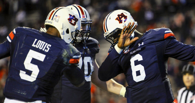 Nov 21, 2015; Auburn, AL, USA; Auburn Tigers quarterback Jeremy Johnson (6) celebrates a touchdown with wide receiver Ricardo Louis (5) during the third quarter against the Idaho Vandals at Jordan Hare Stadium. Auburn won 56-34. Mandatory Credit: Shanna Lockwood-USA TODAY Sports