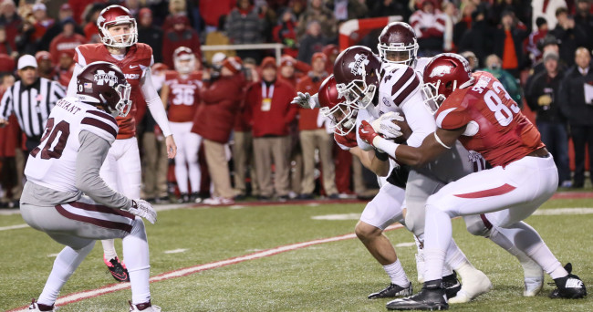Nov 21, 2015; Fayetteville, AR, USA; Arkansas Razorbacks kicker Cole Hedlund (9) looks on after attempting a game winning field goal in the final minute of the fourth quarter against as Mississippi State Bulldogs linebacker Beniquez Brown (42) recovers the blocked kick at Donald W. Reynolds Razorback Stadium. Mississippi State defeated Arkansas 51-50. Mandatory Credit: Nelson Chenault-USA TODAY Sports