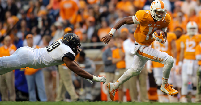 Nov 28, 2015; Knoxville, TN, USA; Tennessee Volunteers quarterback Joshua Dobbs (11) runs the ball against the Vanderbilt Commodores during the first half at Neyland Stadium. Mandatory Credit: Randy Sartin-USA TODAY Sports