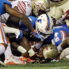 Nov 28, 2015; Gainesville, FL, USA; Florida Gators linebacker Jarrad Davis (40) stops Florida State Seminoles running back Dalvin Cook (4) on the one yard line during the second quarter at Ben Hill Griffin Stadium. Mandatory Credit: Kim Klement-USA TODAY Sports