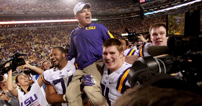Nov 28, 2015; Baton Rouge, LA, USA; LSU Tigers head coach Les Miles is picked up by his players after defeating the Texas A&M Aggies 19-7 at Tiger Stadium. Mandatory Credit: Crystal LoGiudice-USA TODAY Sports