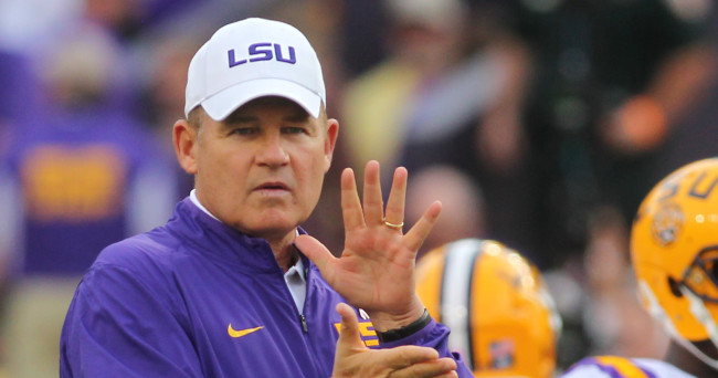 Oct 17, 2015; Baton Rouge, LA, USA; LSU Tigers head coach Les Miles claps as the team warms up prior to kickoff against the Florida Gators at Tiger Stadium. LSU defeated Florida 35-28. Mandatory Credit: Crystal LoGiudice-USA TODAY Sports