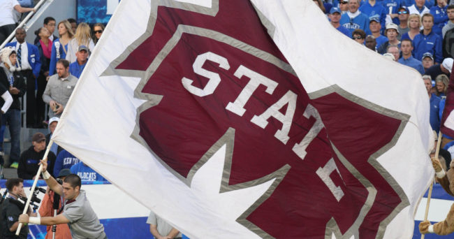 Oct 25, 2014; Lexington, KY, USA; A Mississippi State Bulldogs cheerleader displays the flag after his team scored a touchdown against the Kentucky Wildcats in the second half at Commonwealth Stadium. Mississippi State defeated Kentucky 45-31. Mandatory Credit: Mark Zerof-USA TODAY Sports